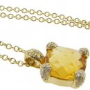A 18k Yellow Gold Citrine and Brilliant Cut Diamond Pendant.